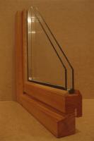 остекление балкона деревянной рамой со стеклопакетом