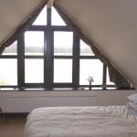 Безскатные чердачные окна